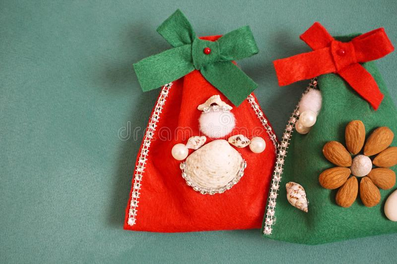 Felt homemade Christmas gift bags decorated with seashells and beads. Felt homemade Christmas gift bags decorated with angel made from seashells, beads and stock photos