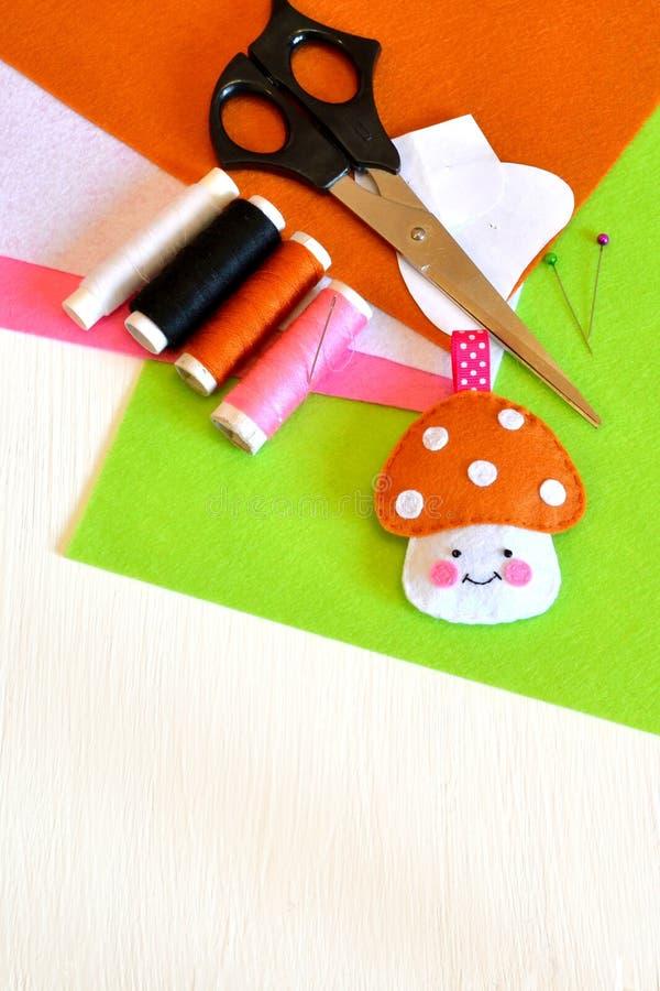 Felt mushroom, thread, needle, paper templates, pins, scissors stock photo