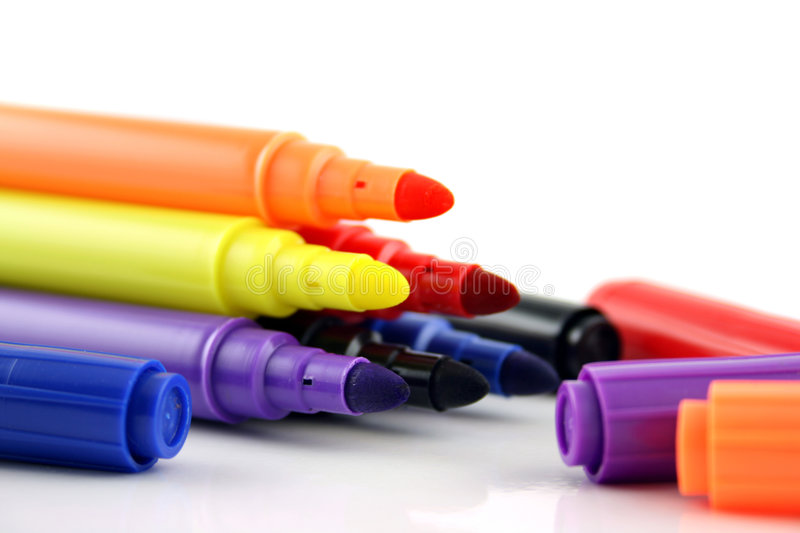Felt Pens and lids close up royalty free stock photo