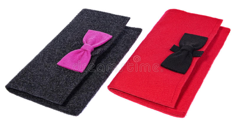 A felt, textile ladies handbags, handmade purses with bows in the color black stock image