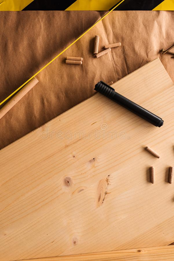 Felt tip pen on woodwork carpentry workshop table. With other tools of trade for diy hobby project stock photography