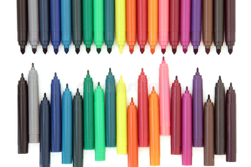 Felt Tip Pens. Coloured felt tip pens over white background royalty free stock photos