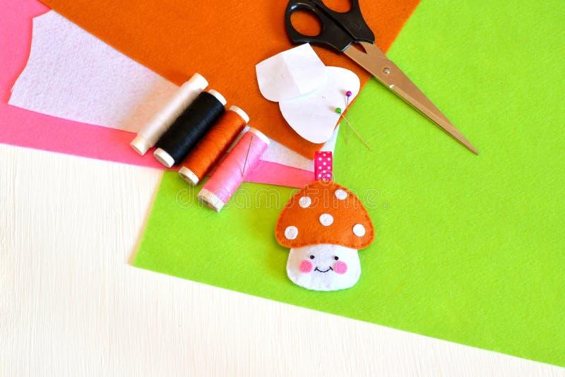 Felt toy mushroom, thread, needle, scissors. Tutorial stock photos