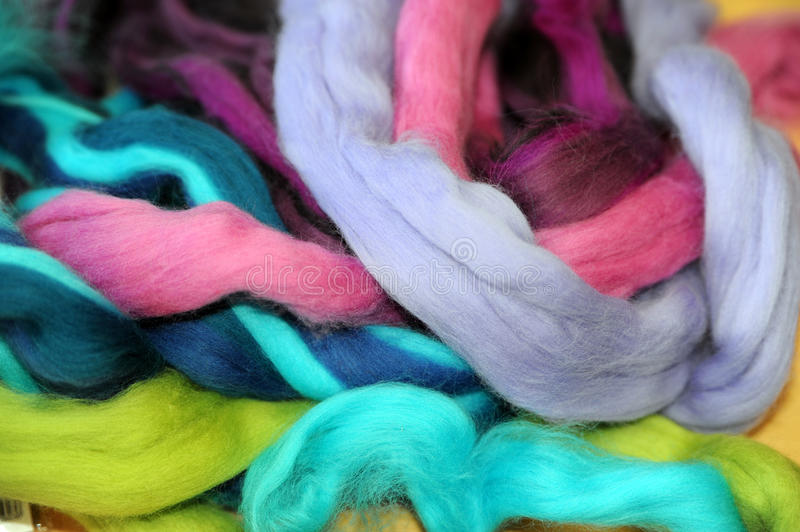 Felting wool. Colorful ropes of felting wool royalty free stock photo