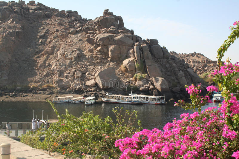 Felucca on the Water - View from Philae Temple [Agilkai Island, Near Aswan, Egypt, Arab States, Africa]. A felucca is a traditional wooden sailing boat used in stock photography