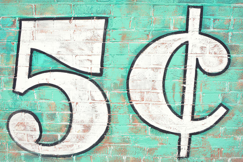 Fem cent tegelstenvägg arkivfoton