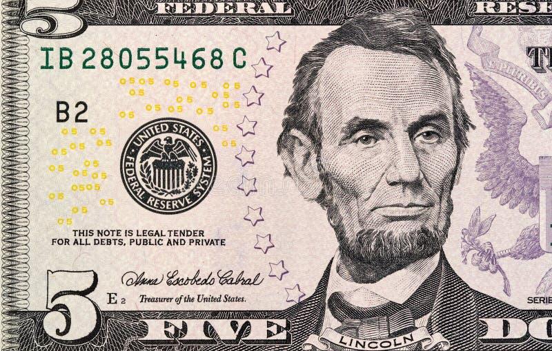 Fem dollar makro för ny upplaga för räkningfragment royaltyfria foton