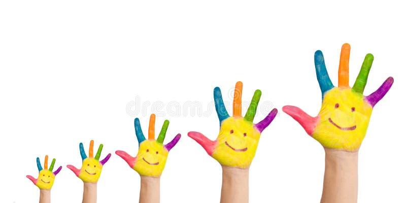 Fem färgrika händer med leende royaltyfri foto