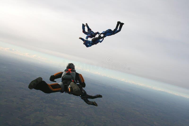 fem skydivers royaltyfria foton