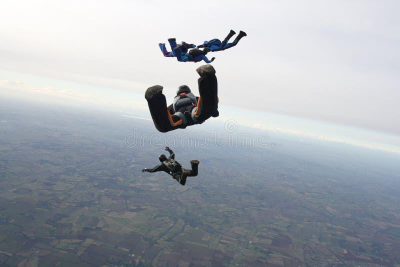fem skydivers royaltyfria bilder