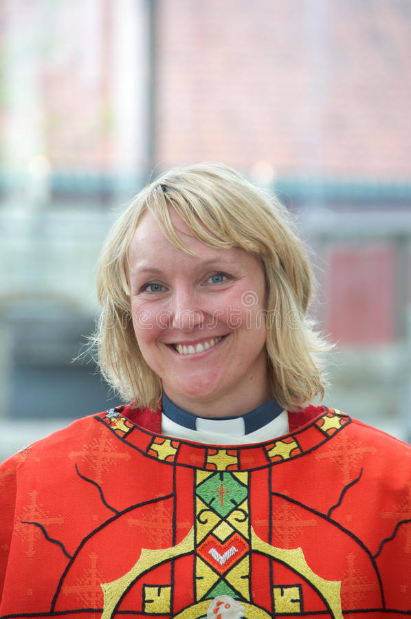 Femal minister in chasuble. Female minister in Church of Norway wearing chasuble for pentacost stock photography