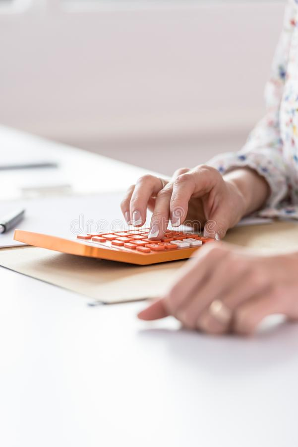 Female accountant or banker making calculations royalty free stock image