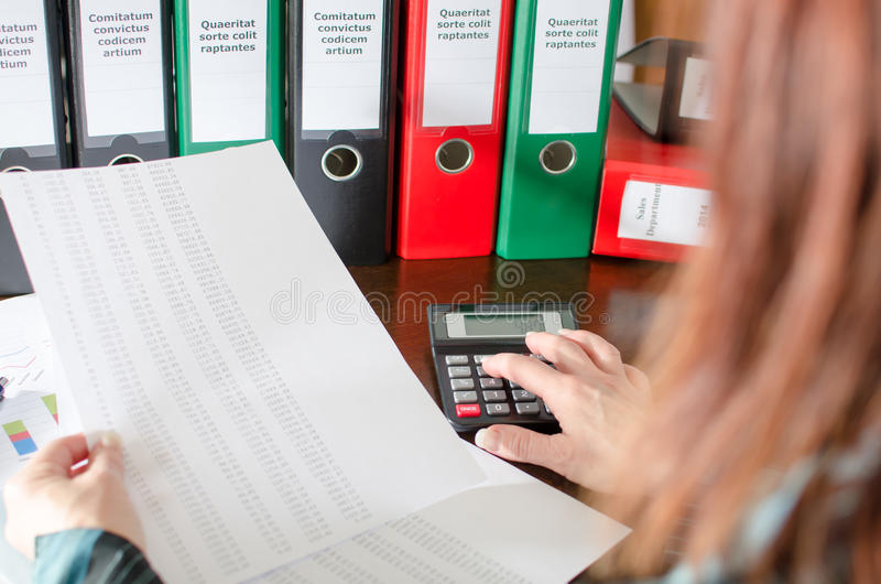 Female accountant checking financial documents stock images