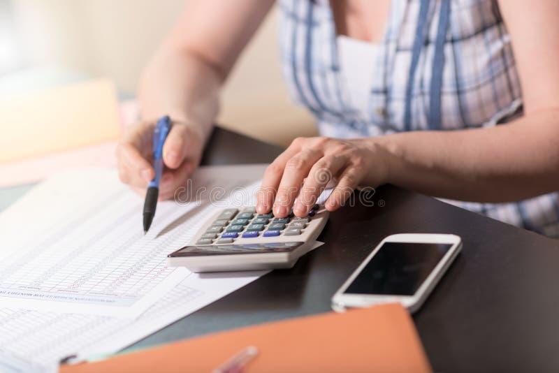 Female accountant using calculator stock photo