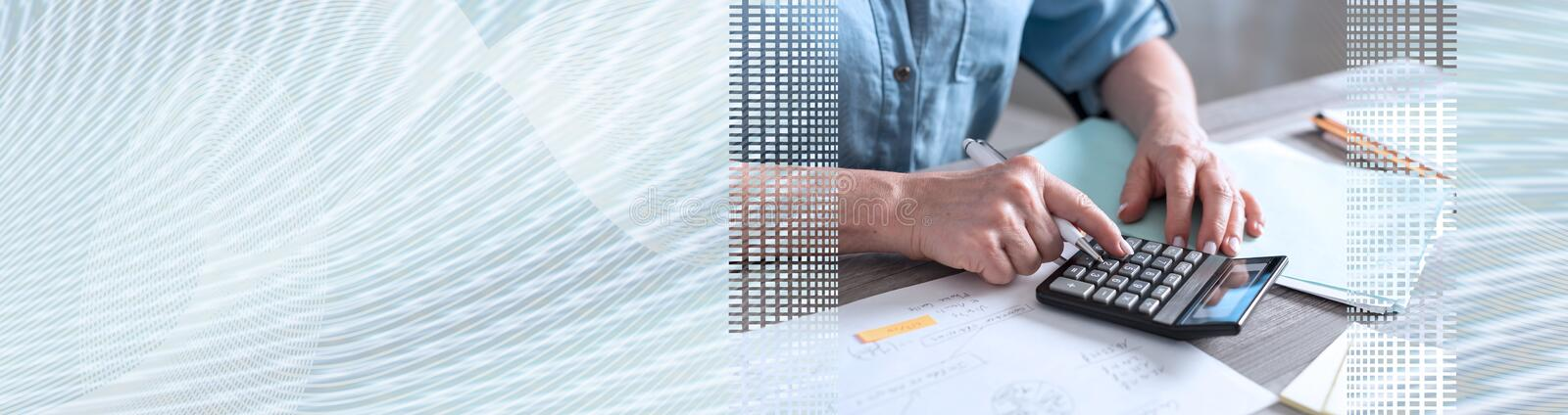 Female accountant using calculator. panoramic banner. Female accountant using calculator in office. panoramic banner stock photos