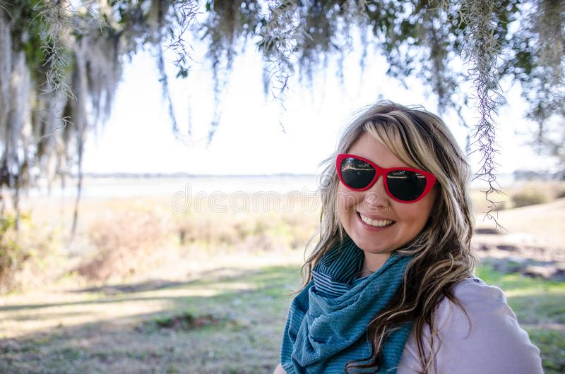 Female adult portrait of a blonde Caucasian woman underneath Spanish Moss in Beaufort, South Carolina royalty free stock image