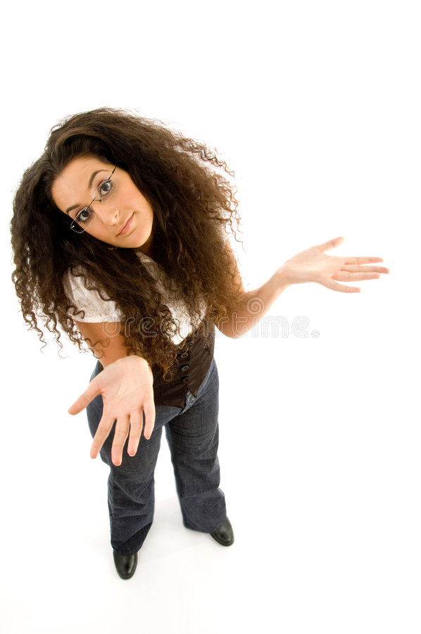 Female adult shrugging her shoulders. Against white background stock photo