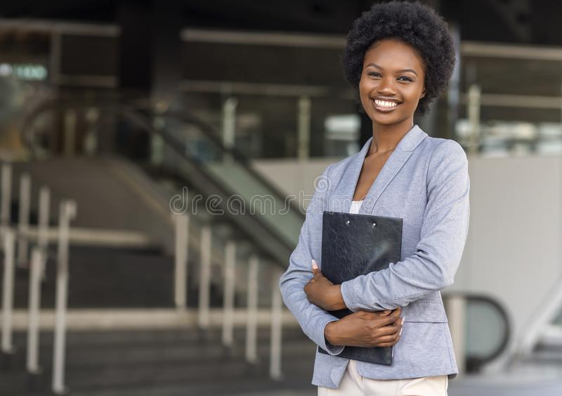 Female African American job seeker keeping a folder with CV royalty free stock photography