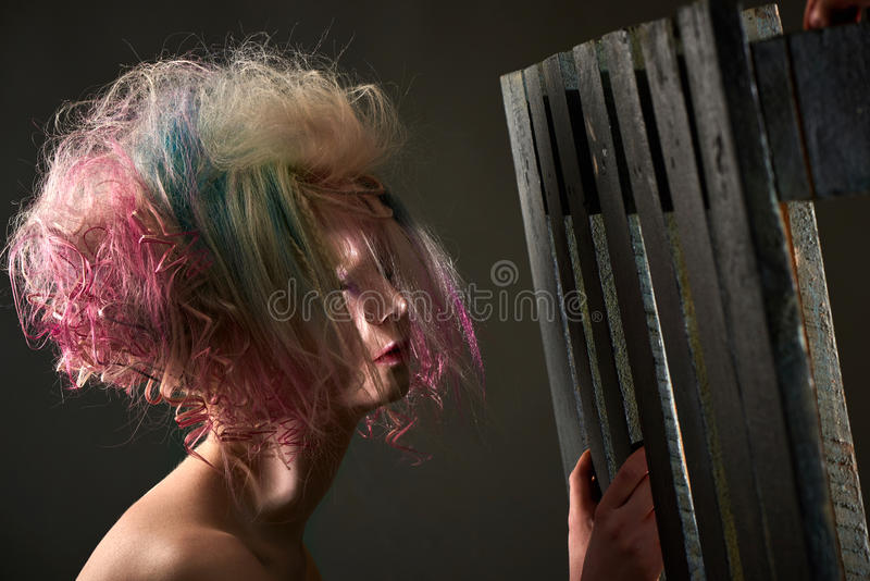 Female albino with dyed hair, professional hair coloring. Portrait of a beautiful female albino with dyed hair, professional hair coloring royalty free stock photography