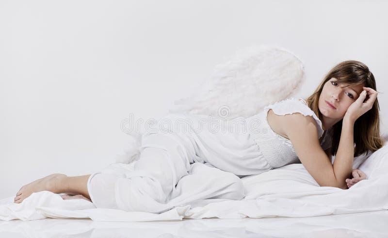 Female angel thinking stock image