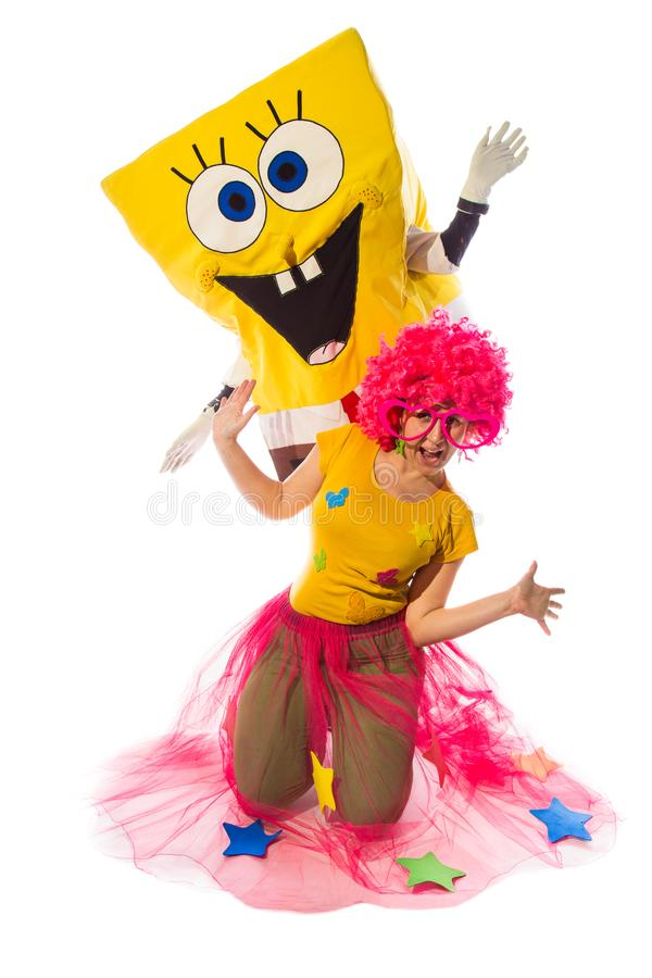 Female animator with fany suit and costumed characters of sponge. NOVI SAD, SERBIA-DEC 1, 2016: Female animator with fany suit and costumed characters of royalty free stock photography