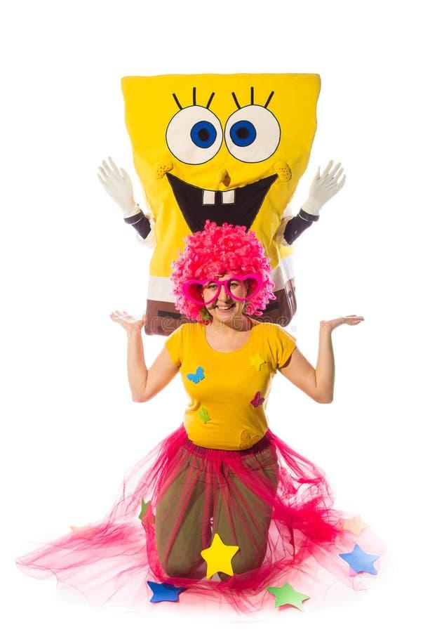 Female animator with fany suit and costumed characters of sponge. NOVI SAD, SERBIA-DEC 1, 2016: Female animator with fany suit and costumed characters of royalty free stock image