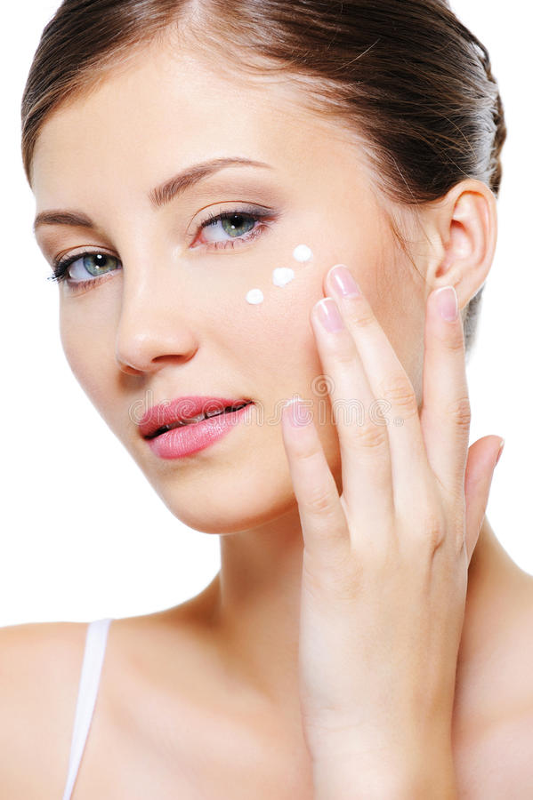 Download Female Applying Cosmetic Cream On Skin Around Eyes Stock Photo - Image: 11385094