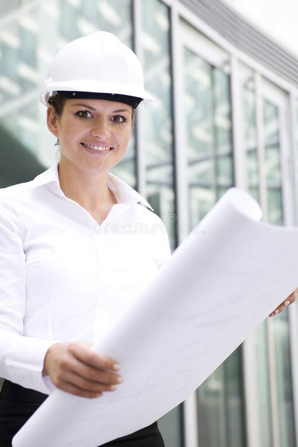 Download Female Architect Holding Blueprints Royalty Free Stock Photography - Image: 6337497