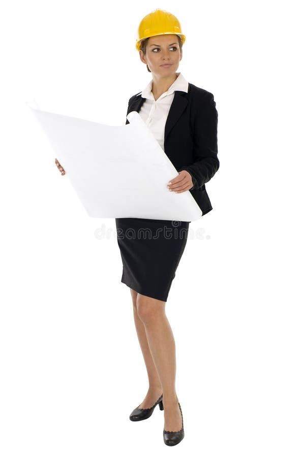 Female architect holding blueprints royalty free stock photography