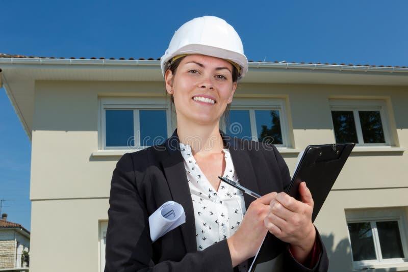 Female architect holding clipboard stock photography