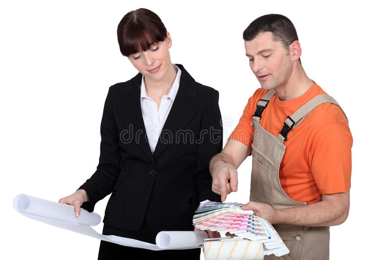 Female Architect And Male Painter Stock Image