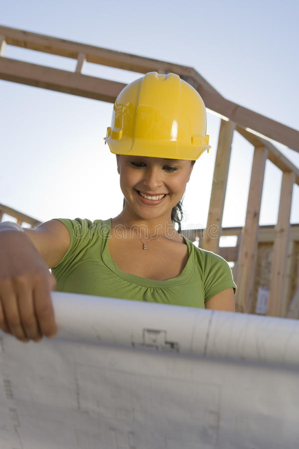 Download Female Architect Reviewing Blueprint Stock Photo - Image: 29655494