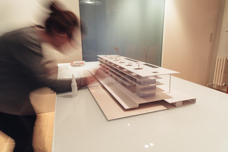 Female architect working on architecture model on table royalty free stock photo