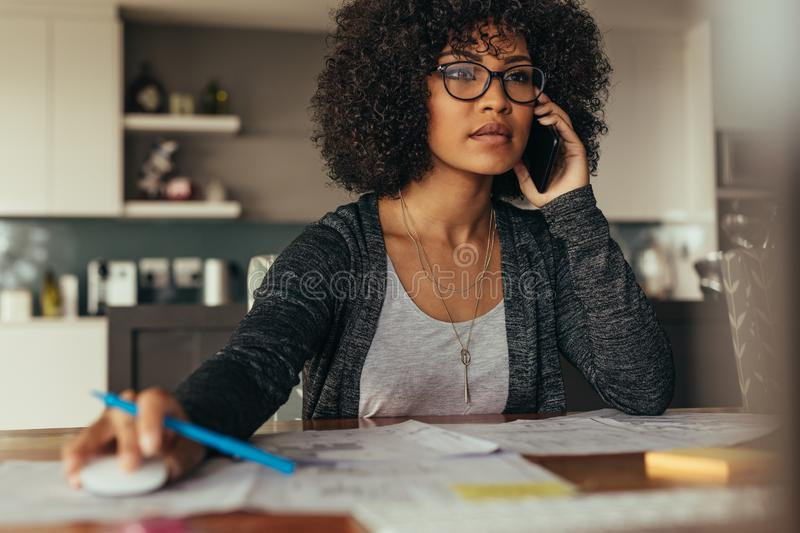 Female architect working from home office stock photo