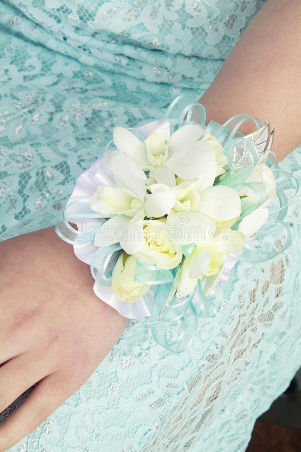 Female arm with corsage for wedding or prom royalty free stock photo