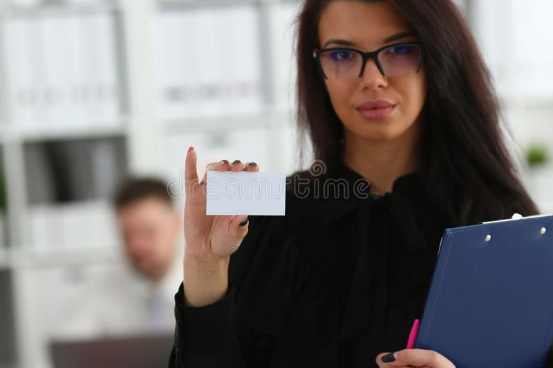 Female arm give blank calling card to visitor. Closeup. White collar colleagues company name exchange job interview sale clerk id executive or ceo finance stock photography