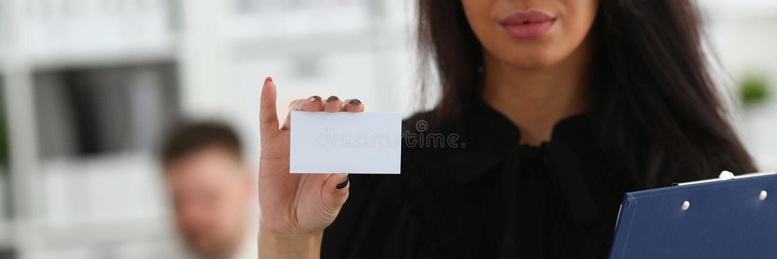 Female arm give blank calling card to visitor. Closeup. White collar colleagues company name exchange job interview sale clerk id executive or ceo finance stock images
