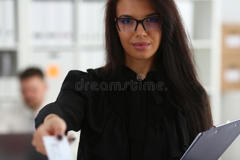 Female arm give blank calling card to visitor. Portrait. White collar colleagues company name exchange job interview sale clerk id executive or ceo finance stock image
