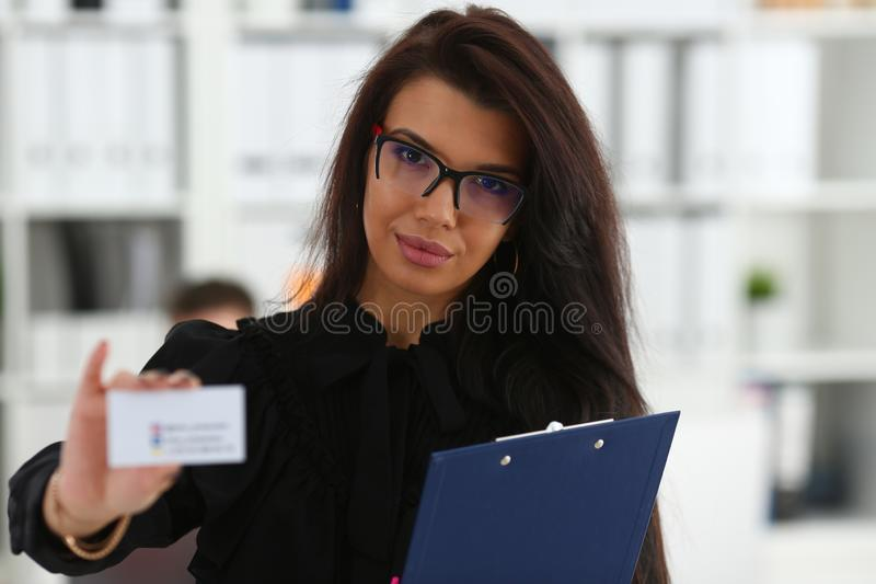 Female arm give blank calling card to visitor. Portrait. White collar colleagues company name exchange job interview sale clerk id executive or ceo finance stock photography