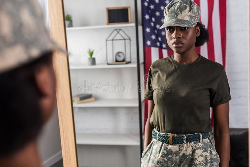 Female army soldier in camouflage clothes posing royalty free stock photo