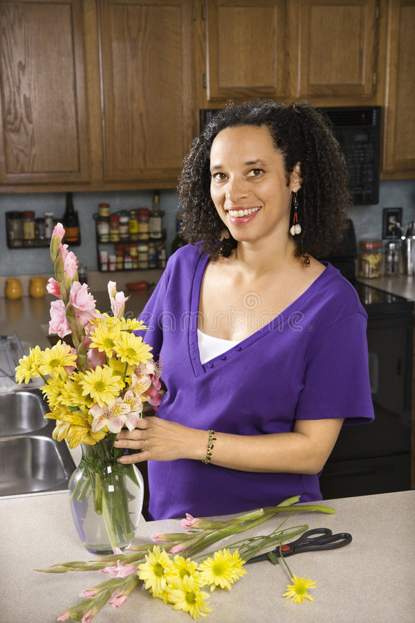 Download Female arranging flowers stock photo. Image of adult, ethnic - 2045008
