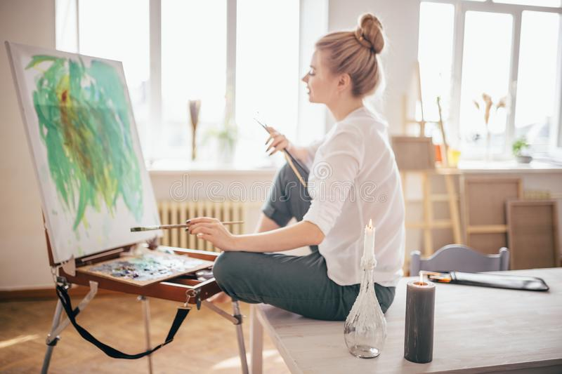 Female art-worker at workplace . full length side view photo. royalty free stock photos