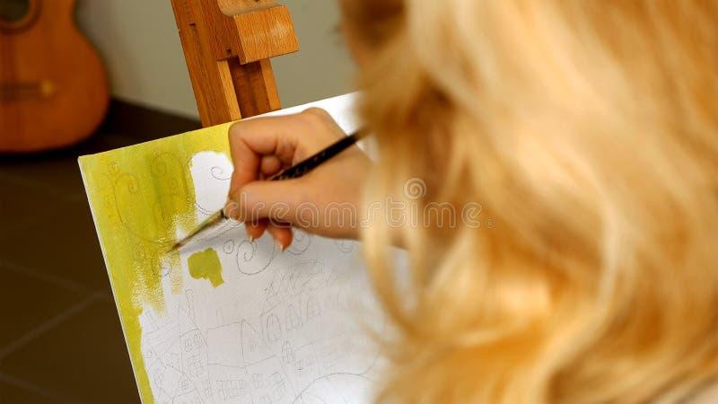 Female artist draws a pencil sketch in art studio stock image
