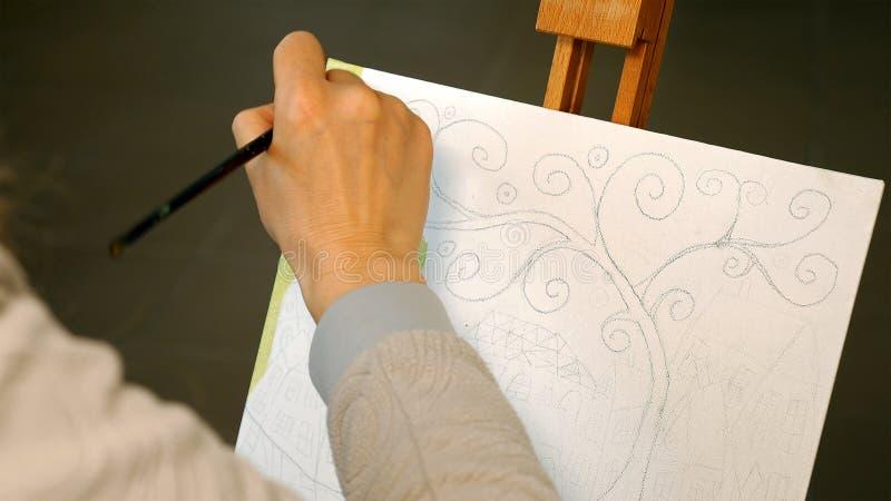 Female artist draws a pencil sketch in art studio royalty free stock photo