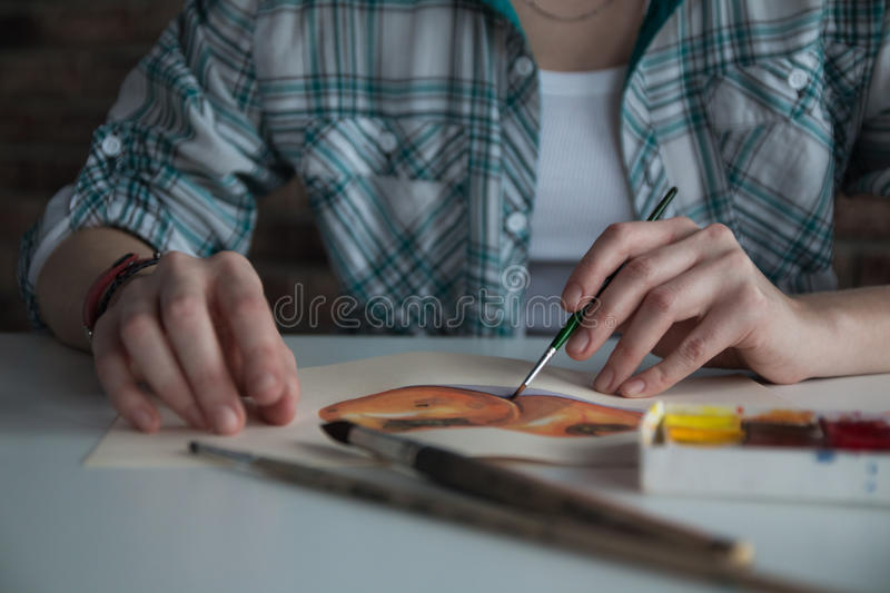 Female artist draws in the room royalty free stock photo
