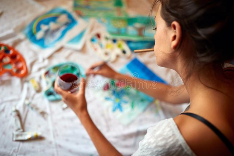 Female artist enjoy in painting royalty free stock image