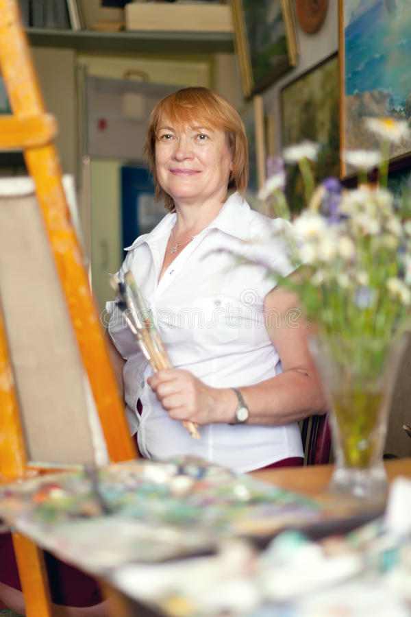 Female Artist Painting A Picture Stock Photo