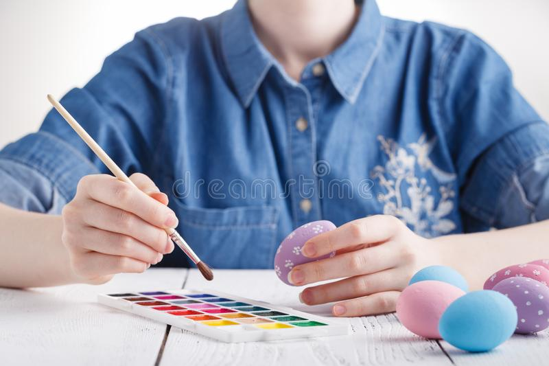 Female artist painting traditional easter egg royalty free stock photography