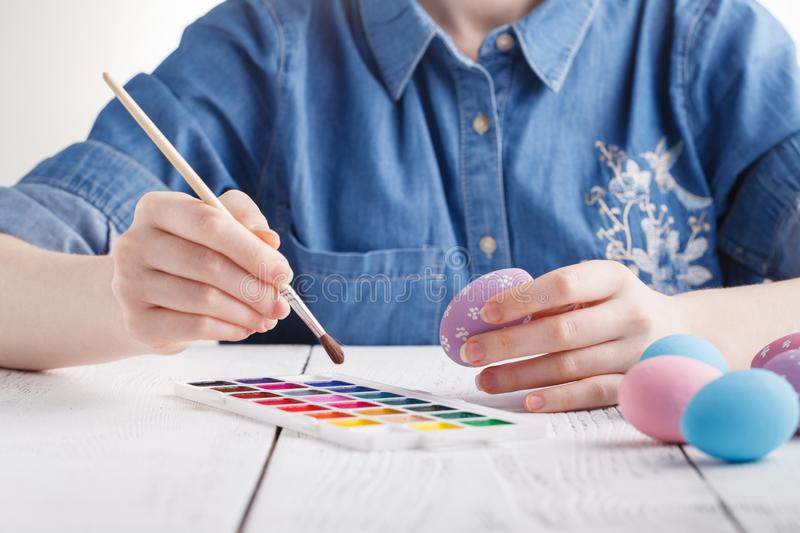 Female artist painting traditional easter egg royalty free stock photo