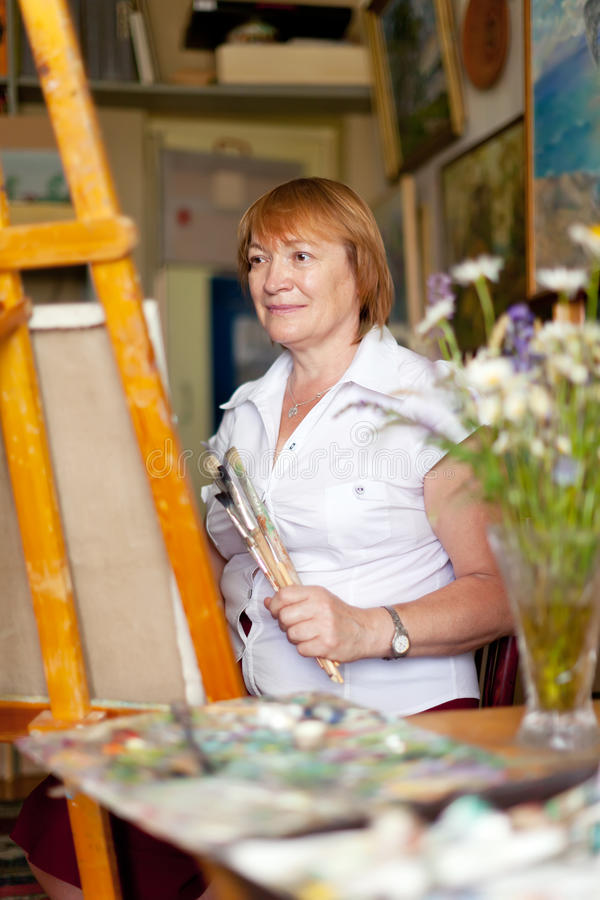 Download Female Artist Paints A Picture On Canvas Stock Photo - Image: 43616172